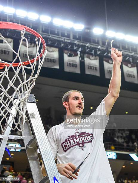 Texas AM Aggies guard Alex Caruso cuts down the net after winning the SEC Championship following the the Vanderbilt Commodores vs Texas AM Aggies...