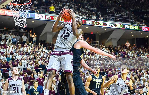 Texas AM Aggies guard Jalen Jones snags a rebound over Vanderbilt Commodores center Josh Henderson during the Vanderbilt Commodores vs Texas AM...