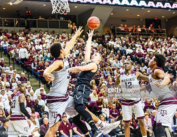 Vanderbilt Commodores guard Riley LaChance throws up a floater as he takes a knee to the goin from Texas AM Aggies center Tyler Davis during the...