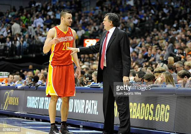 Houston Rockets power forward Donatas Motiejunas chats with Houston Rockets head coach Kevin McHale during an NBA game between the Houston Rockets...