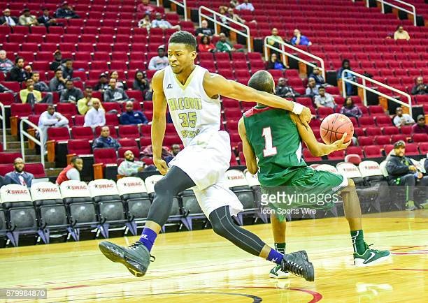 Alcorn State Braves forward Octavius Brown pulls Mississippi Valley State Delta Devils guard Marcus Romain down from behind on a breakaway steal...