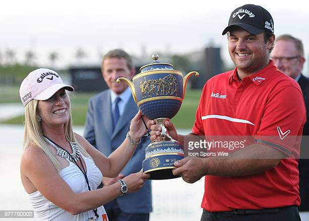 March 09 Patrick Reed and wife Justine hold the Trophy after winning the PGA World Golf Championship Final Round at Trump National Doral in Doral...