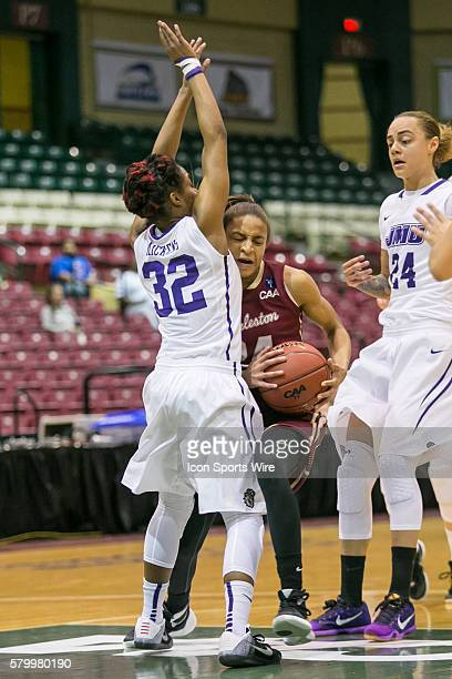 Charleston Cougars forward Breanna Bolden tries to draw the foul from James Madison Dukes guard Angela Mickens during the game between Charleston...