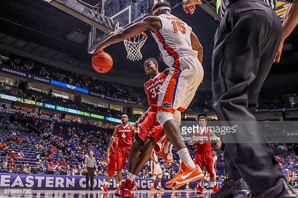 Florida Gators center John Egbunu saves the ball from going out of bounds during the SEC Men's Basketball Championship Tournament game between...