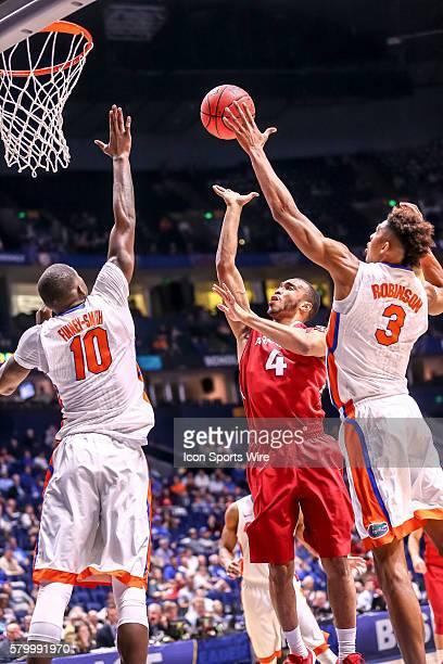 Florida Gators forward Devin Robinson blocks a shot by Arkansas Razorbacks guard Jabril Durham during the SEC Men's Basketball Championship...