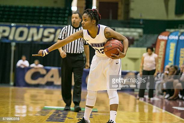 James Madison Dukes guard Angela Mickens directs the offense during the game between Charleston Cougars vs James Madison Dukes at Showplace Arena in...