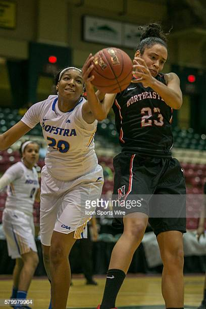 Northeastern Huskies forward Samantha DeFreese and Hofstra Pride forward Anjie White fight for the ball during the game between Northeastern Huskies...