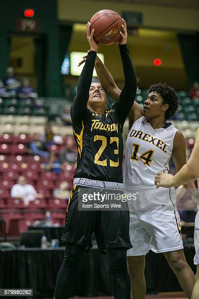 Towson Tigers forward Brittany Tarr is fouled by Drexel Lady Dragons guard/forward Sara Woods during the game between Towson Tigers vs Drexel Dragons...