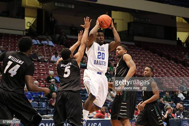Middle Tennessee guard Giddy Potts looks to pass during the opening round game of the CUSA Basketball Tournament between the Charlotte 49ers and the...