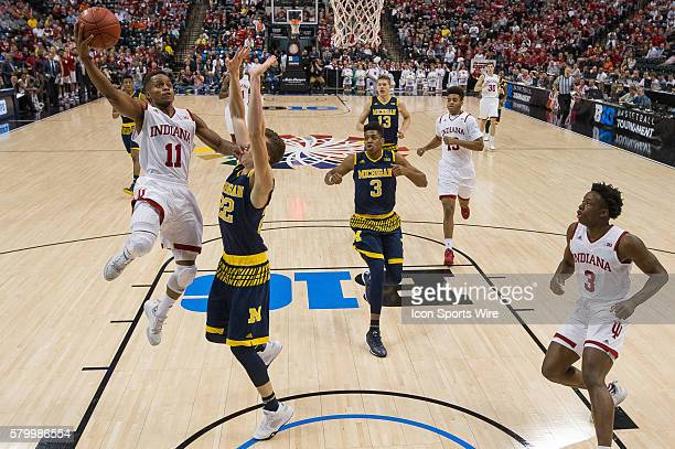 Indiana Hoosiers guard Yogi Ferrell drives to the basket against Michigan Wolverines guard Duncan Robinson during the men's Big Ten Tournament...
