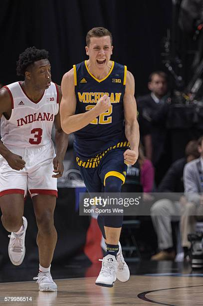 Michigan Wolverines guard Duncan Robinson hits a three pointer to tie the game late during the men's Big Ten Tournament basketball game between the...