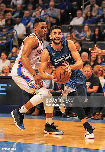 Minnesota Timberwolves Guard Ricky Rubio drives to the basket going by Oklahoma City Thunder Guard Russell Westbrook at the Chesapeake Energy Arena...