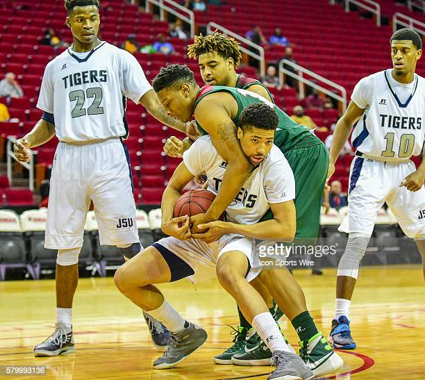 Mississippi Valley State Delta Devils forward Dwain Whitfield reaches over the back to tie up Jackson State Tigers guard Chace Franklin during the...