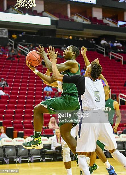 Mississippi Valley State Delta Devils forward Vacha Vaughn drives hard to the basket as Jackson State Tigers guard Paris Collins defends during the...