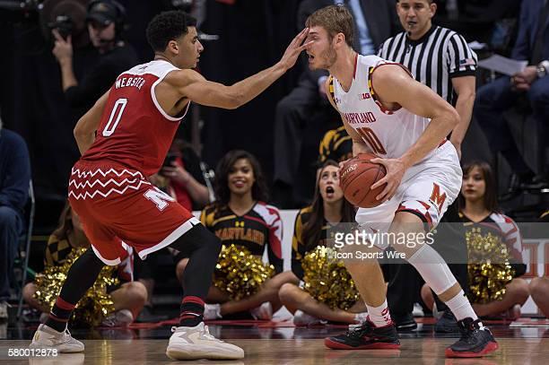 Nebraska Cornhuskers guard Tai Webster defends Maryland Terrapins forward Jake Layman during the men's Big Ten Tournament basketball game between the...