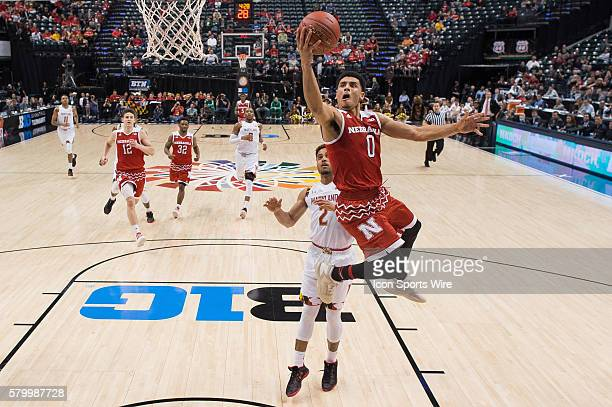 Nebraska Cornhuskers guard Tai Webster gets by Maryland Terrapins guard Melo Trimble for a layup during the men's Big Ten Tournament basketball game...