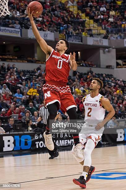 Nebraska Cornhuskers guard Tai Webster scores on a fast break during the men's Big Ten Tournament basketball game between the Nebraska Cornhuskers...