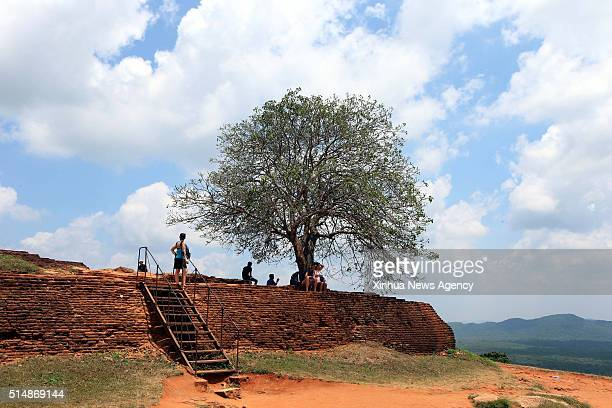 Tourists visit the ancient city of Sigiriya some 170 km northeast of Colombo capital of Sri Lanka on March 8 2016 The ruins of the capital built by...