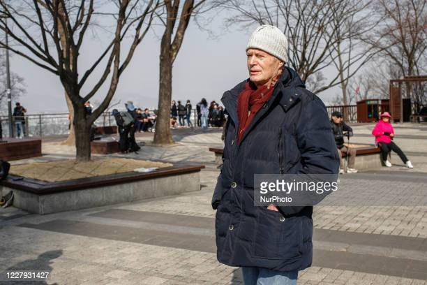 March 11 2018Seoul South KoreaFrench Auther and Professor JeanMarie Le Clezio and his travel team visit Namsan Mountain Park and Tower in Seoul South...