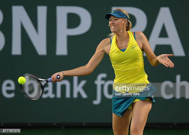 Maria Sharapova hits a return shot during a match against Vera Dushevina during the BNP Paribas Open played at the Indian Wells Tennis Garden