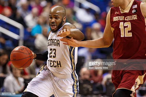 Georgia Tech Yellow Jackets guard Trae Golden drives the ball around Boston College Eagles forward Ryan Anderson during the ACC 2014 basketball...