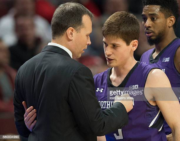 Northwestern Head Coach Chris Collins hugs Dave Sobolewski before the end of the Big Ten Men's Basketball Tournament game between the Northwestern...