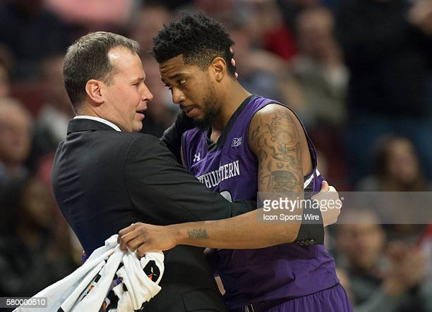 Northwestern Head Coach Chris Collins hugs JerShon Cobb before the end of the Big Ten Men's Basketball Tournament game between the Northwestern...