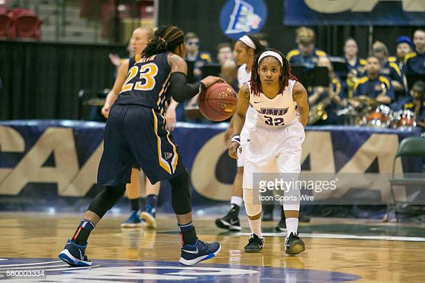 James Madison Dukes guard Angela Mickens plays defense against Drexel Lady Dragons guard Alexis Smith during the CAA Women Championship game between...