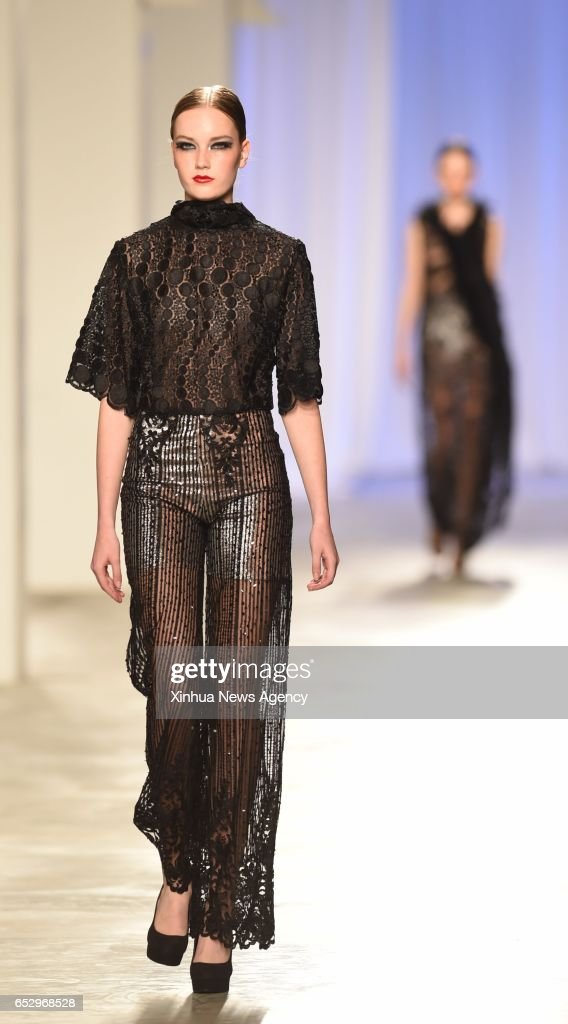 LISBON, March 12, 2017 -- A model presents a creation of designer Nadir Tati at the Lisbon Fashion Week Fall/Winter 2017/18 in Lisbon, capital of Portugal, on March 12, 2017.
