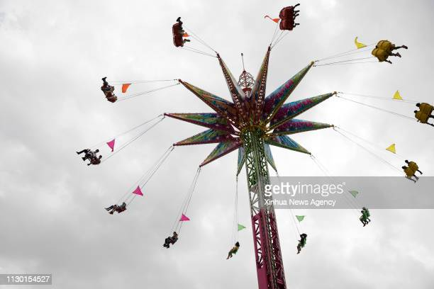 HOUSTON March 12 2019 People enjoy the swing ride at the carnival during the Houston Livestock Show and Rodeo in Houston Texas the United States on...