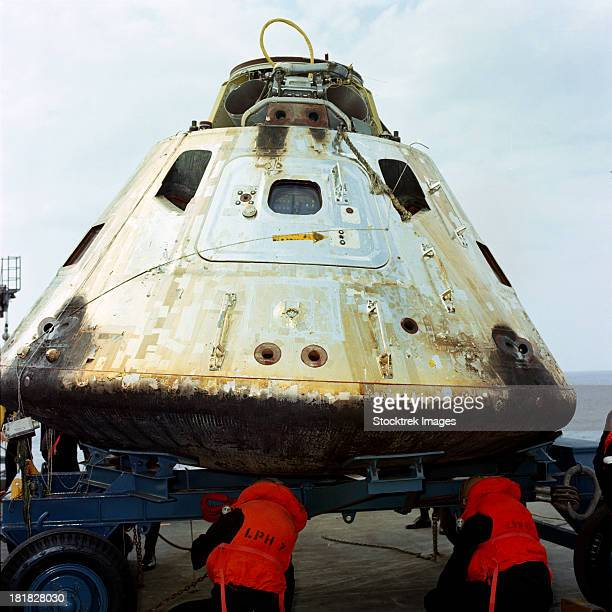 march 13, 1969 - close-up view of the apollo 9 command module (cm) as it sets on dolly on the deck of the uss guadalcanal just after being hoisted from the water.  - space capsule stock photos and pictures