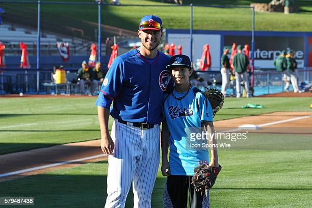 Dallon Cave a player on the US National Champion Mountain Ridge Little League team from Las Vegas poses with Kris Bryant after throwing out the first...