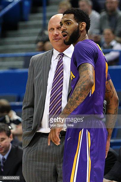 East Carolina's Head Coach Jeff Lebo talks with Guard Terry Whisnant during the American Athletic Conference men's championship quarter finals...
