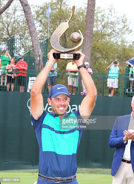 Charl Schwartzel raises the championship trophy after the final round of the Valspar Championship at the Westin Innisbrook in Palm Harbor, FL..