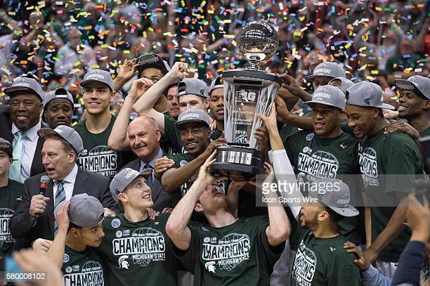 Michigan State Spartans celebrate after the men's Big Ten Tournament Championship game between the Purdue Boilermakers and Michigan State Spartans at...