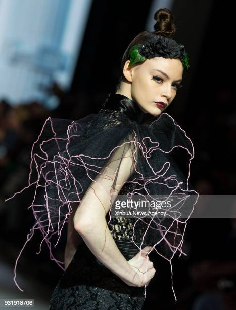 TORONTO March 13 2018 A model presents a creation by Stephan Caras during the Toronto Women's Fashion Week 2018 Fall/Winter in Toronto Canada March...