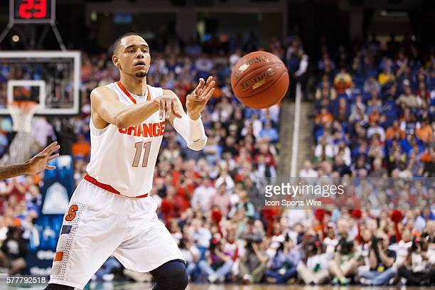 Syracuse Orange guard Tyler Ennis passes the ball during the ACC 2014 basketball tournament game between Syracuse Orange and North Carolina State...