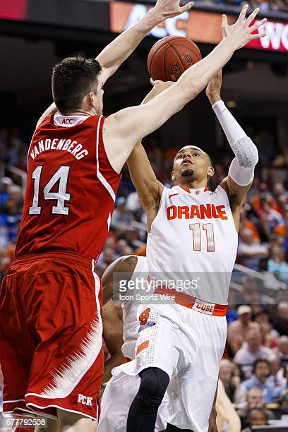 Syracuse Orange guard Tyler Ennis shoots the ball in front of North Carolina State Wolfpack center Jordan Vandenberg during the ACC 2014 basketball...