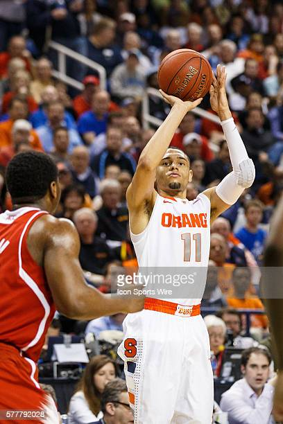 Syracuse Orange guard Tyler Ennis shoots the three point shot during the ACC 2014 basketball tournament game between Syracuse Orange and North...