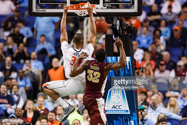 Virginia Cavaliers forward Darion Atkins dunks the ball past Florida State Seminoles guard Montay Brandon during the ACC 2014 basketball tournament...
