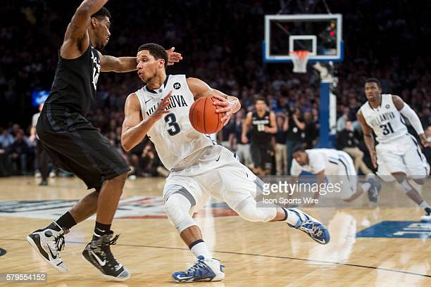 Josh Hart pushes he way past Remy Abell during the Xavier Musketeers game versus the Villanova Wildcats in the championship game of the Big East...