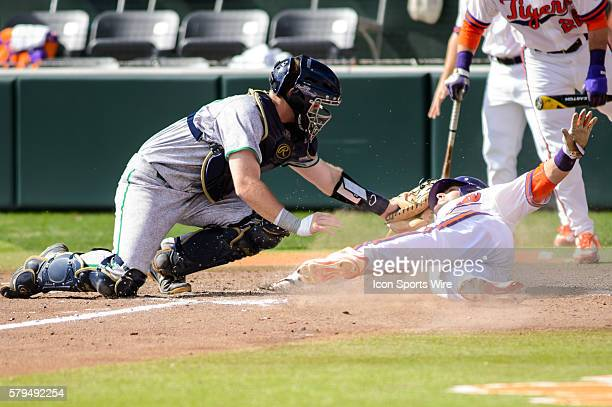 Notre Dame Fighting Irish catcher Ryan Lidge tags Clemson Tigers outfielder Steven Duggar out at home during Game 1 of a doubleheader between Notre...