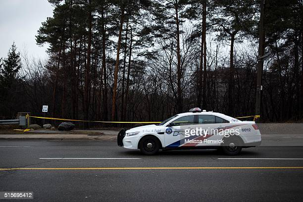 TORONTO ON March 14 A police car drives past police tape around the park near Don River Trail at Sheppard Avenue and Leslie Street where the fatal...