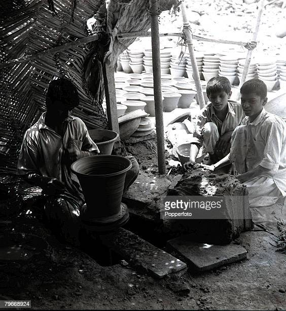 March 14th Young workers at a Karachi Pakistan earthenware factory
