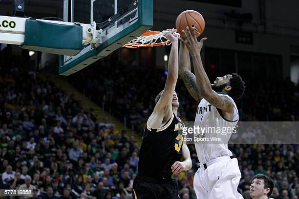 March 11 2014 Wright State Raiders forward Jerran Young goes strong to the hoop against Milwaukee Panthers forward Kyle Kelm during the Horizon...