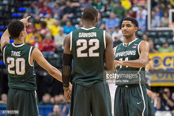 Michigan State Spartans guard Gary Harris , Michigan State Spartans guard Travis Trice and Michigan State Spartans forward Branden Dawson celebrate...