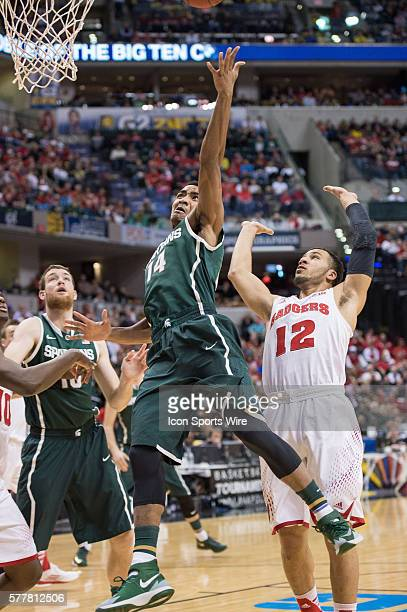Michigan State Spartans guard Gary Harris scores in the lane in front of Wisconsin Badgers guard Traevon Jackson during the Big Ten Men's Basketball...