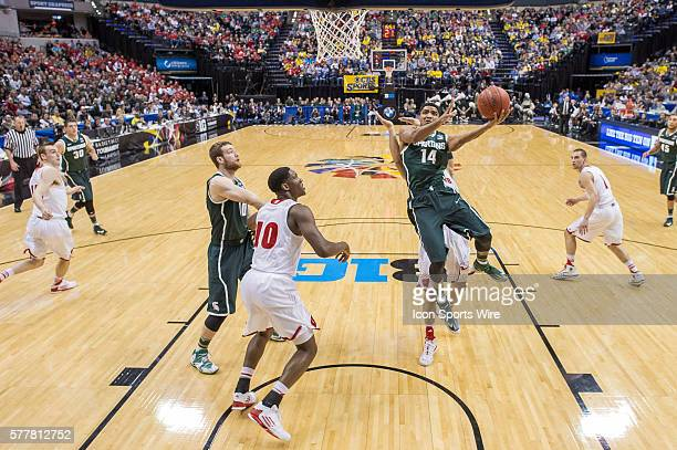 Michigan State Spartans guard Gary Harris scores in the lane during the Big Ten Men's Basketball Tournament game between the Wisconsin Badgers vs...