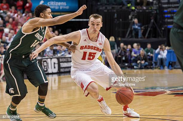 Wisconsin Badgers forward Sam Dekker drives in the lane by Michigan State Spartans guard Gary Harris during the Big Ten Men's Basketball Tournament...