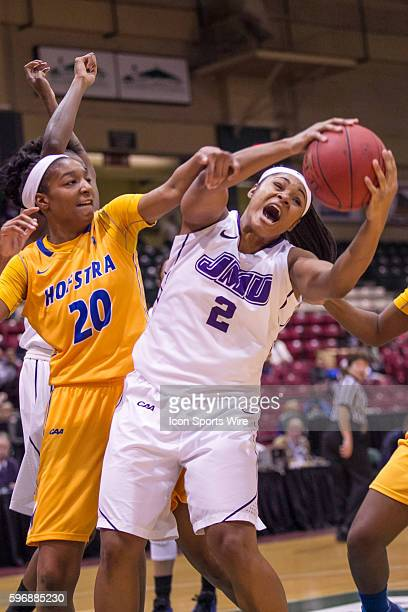 James Madison Dukes forward Destiny Jones grabs the rebound from Hofstra Pride forward Anjie White during the CAA Women's championship game between...